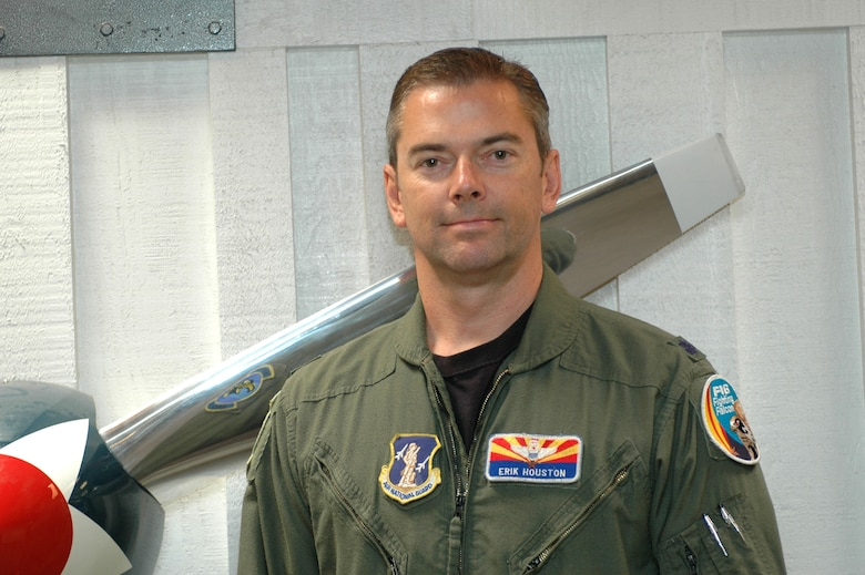 """Lt. Col. Erik Houston Instructor Pilot  """"I was a pilot for American Airlines at the time. When I first heard about the plane hitting the tower, I immediately thought it must have been bad weather and some issues with navigation. I turned on the TV and saw that it was a beautiful day and the second plane hit, and we all knew it was no mistake. After that, I went back into the National Guard.""""  (Air Force photo by Airman 1st Class Krystal Tomlin)"""
