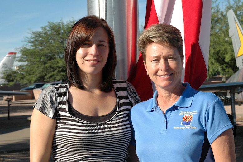 """Samantha Ithal Retention  Barb Gavre 162nd Family Readiness Group  Samantha Ithal stands with her mother, Barb Gavre from family readiness, who remembers dropping her daughter off at school before she heard the news about the towers.   """"I remember being at school watching the news and everybody was bawling even though we didn't know anybody who was involved in it.""""   (Air Force photo by Airman 1st Class Krystal Tomlin)"""