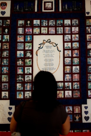 A woman looks at a 9/11 tribute quilt before an annual memorial luncheon held for him on the anniversary of his death, New York, Sept 11. Bucca is the only fire marshal killed in the line of duty. (Official Marine Corps photo by Sgt. Randall A. Clinton)