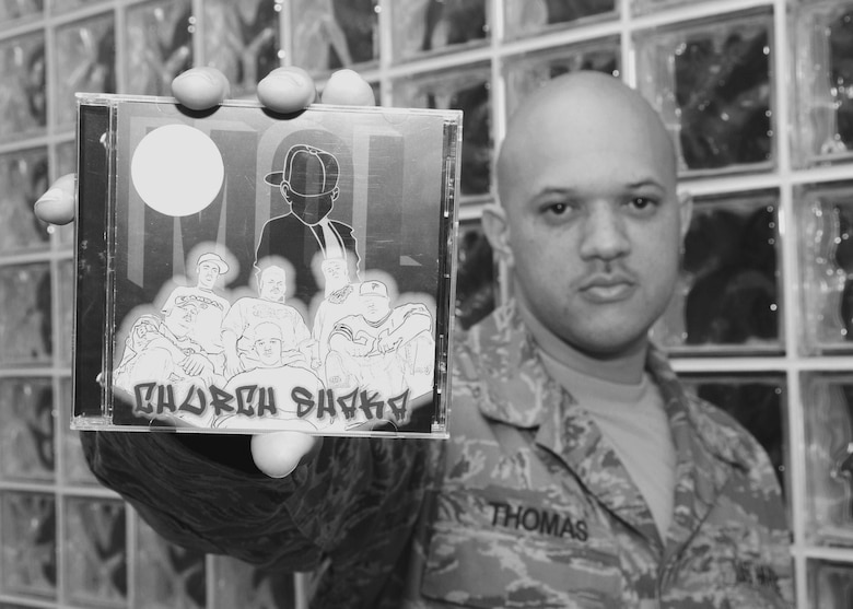 """Tech Sgt. Lesley Thomas, a member of the 137 Air Refueling Wing's Finance Office, poses with his rap group's latest CD, """"Church Shaka,"""" by Mobsters of Light.  Sgt. Thomas says MOL performs across the country in churches, concerts, alternative schools and juvenile centers."""