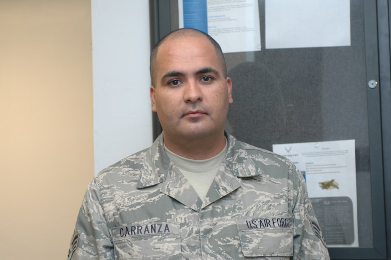 """Senior Airman Ruben Carranza, 162nd Financial Management - Airman Carranza was listening to the radio at a civilian job when he found out about the attacks. Having no access to a television, he didn't actually know what happened until his wife picked him up from work. The first words to come out of her mouth were about the attacks. They spent the rest of the day watching the news. """"I remember just watching the news for the whole afternoon with my wife. We just kept watching the replay of the towers falling over and over again. I think we fell asleep watching the news without talking about anything else. It was that big of an impact."""" (Air Force photo by Airman 1st Class Krystal Tomlin)"""