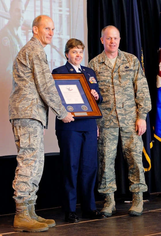 Retired Master Sgt. Nancy Young and Maj. Gen. William Reddel III, the Adjutant General of the N.H. National Guard, hold a rosewood encased, framed, personalized letter of appreciation from General McKinley as part of the 157th Air Refueling Wing's first Hometown Heroes celebration. Also pictured is Chief Master Sgt. Christopher Muncy, Command Chief Master Sgt. of the Air National Guard