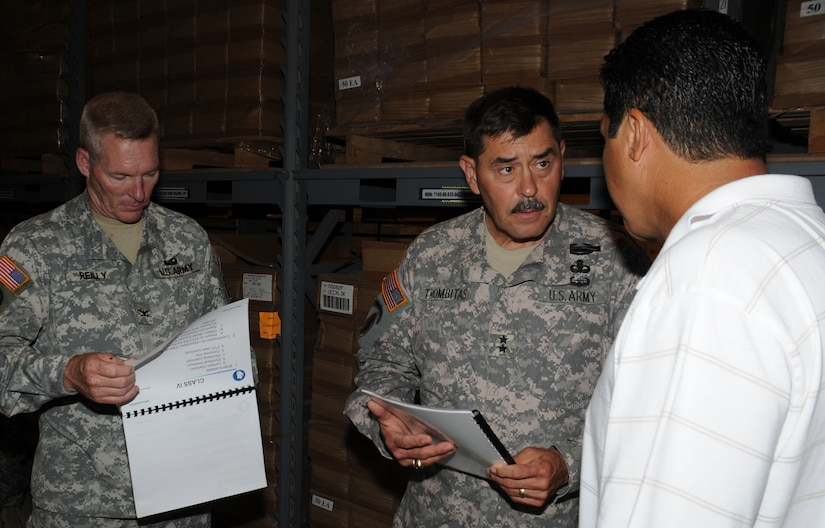 SOTO CANO AIR BASE, Honduras --  Col. Gregory Reilly, the Joint Task Force-Bravo commander, left, and Maj. Gen. Simeon Trombitas receive a mission briefing from Mr. Victor Vega, the U.S. Army South equipment manager, here Sept. 11. General Trombitas took command of USARSO on Nov. 9, 2009. (U.S. Air Force photo/Tech. Sgt. Benjamin Rojek)