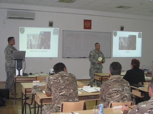 U.S. Army Maj. Mrunal Vyas (left) and Col. Steve Katz of the Army Civil Military Operations team instructs a class during the 2010 Medical Training Exercise in Central and Eastern Europe (MEDCEUR) Sept. 9 in Montenegro. This is Colonel Katz's third time supporting MEDCEUR teaching the basics of emergency planning and response to partner nations. For more information, go to www.usafe.af.mil/medceur.asp and www.odbrana.gov.me. (U.S. Army photo courtesy of Lt. Col. Jeff Gabel)