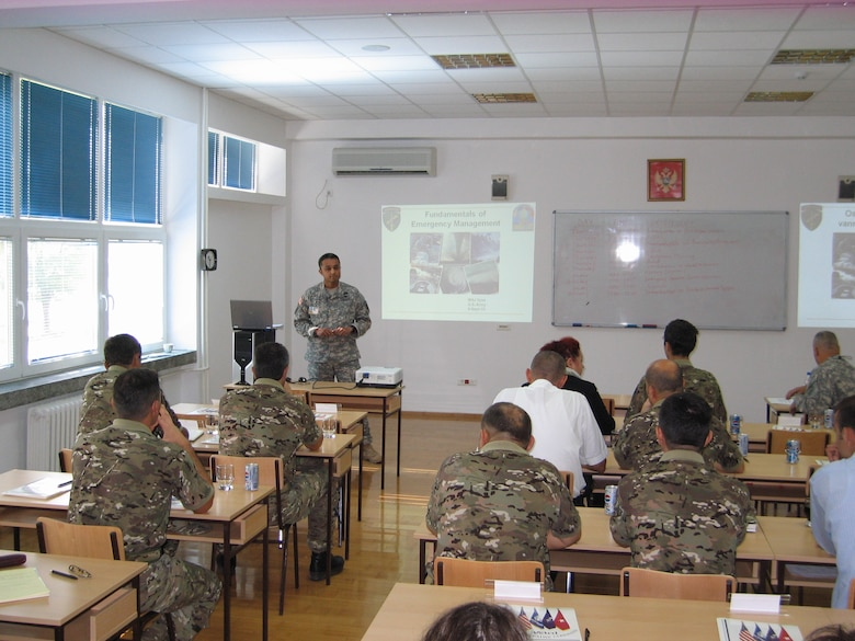 U.S. Army Maj. Mrunal Vyas of the Army Civil Military Operations team instructs a class during the 2010 Medical Training Exercise in Central and Eastern Europe (MEDCEUR) Sept. 9 in Montenegro. The Civil Military Operations team teaches the basics of emergency planning and response to servicemembers of the ten nations participating in the exercise. For more information, visit www.usafe.af.mil/medceur.asp and www.odbrana.gov.me. (U.S. Army photo courtesy of Lt. Col. Jeff Gabel)