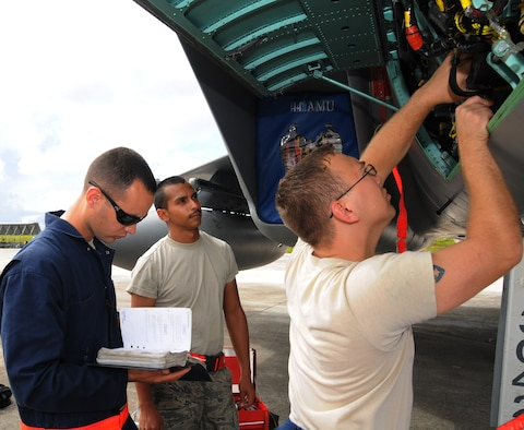 ANDERSEN AIR FORCE BASE, Guam - Senior Airman Angel Rivera, Airman 1st Class Paul Altamira and Staff Sgt. Steve Newcomb, Electrical and Environmental technicians troubleshoot a generator on a F-15E Strike Eagle here Sept. 13. The Airmen are from the 18th Aircraft Maintenance Squadron, Kadena Air Base, Japan, and are here participating in Valiant Shield 2010, a U.S. Pacific Command exercise, from September 12 to 21. The exercise focuses on integrated joint training and interoperability among U.S. military forces while responding to a range of mission scenarios. (U.S. Air Force photo by Senior Airman Nichelle Anderson)
