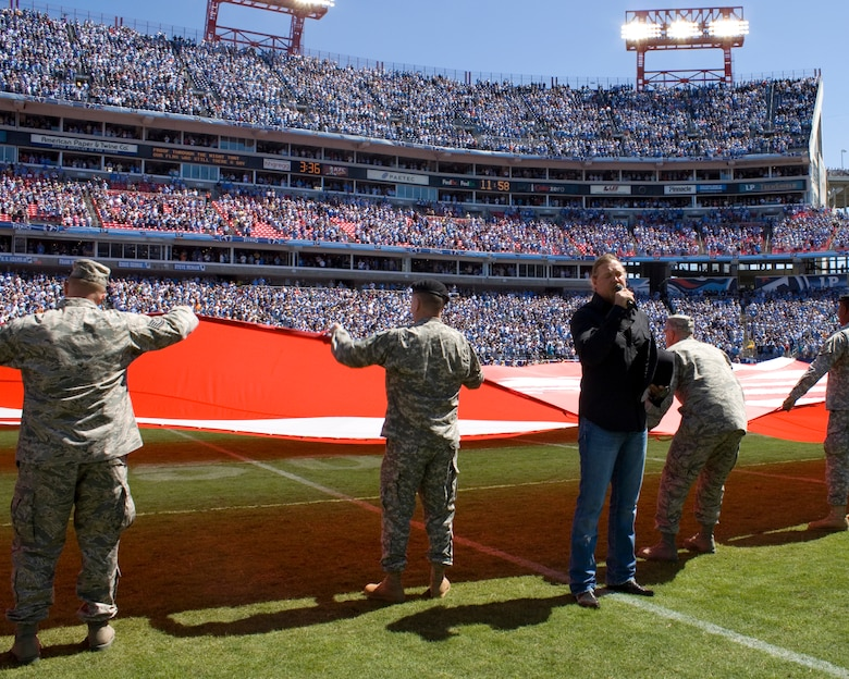 Country music star Trace Adkins, sings the national anthem in front of more than 140 Tennessee National Guard Soldiers and Airmen to kickoff the first game of the Titans season, Sept. 12.
