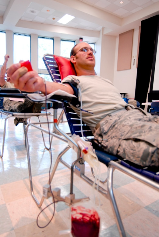 Technical Sgt. James Gerschutz, 180th Fighter Wing, donates blood at a Red Cross blood drive hosted at the 180th Fighter Wing, September 8. The 180th FW has been hosting blood drives for unit members since 2004. Throughout that time, 180th members have donated 438 units of blood. (U.S. Air Force Photo by Master Sgt. Beth Holliker/Released).