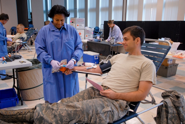 Staff Sgt. Nathan Goff, 180th Fighter Wing, donates blood at a Red Cross blood drive hosted at the 180th Fighter Wing, September 8. The 180th FW has been hosting blood drives for unit members since 2004. Throughout that time, 180th members have donated 438 units of blood. (U.S. Air Force Photo by Master Sgt. Beth Holliker/Released).