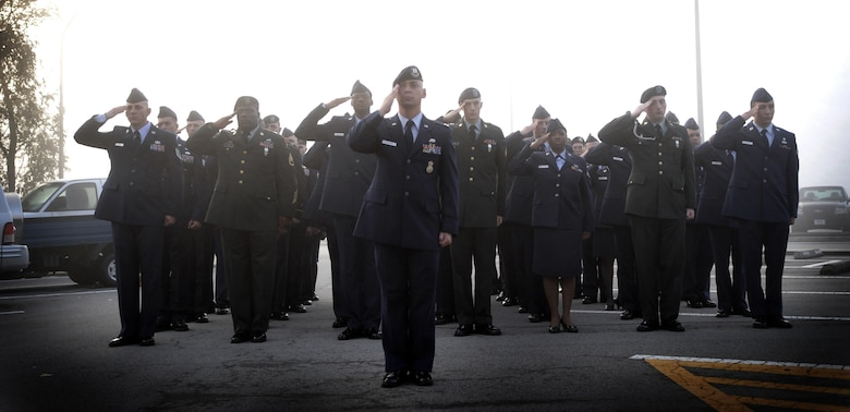 Airmen and Soldiers salute during a reveille ceremony Sept. 13, the first of several events this week leading up to National POW/MIA Day. Osan will honor the POW/MIA Day the entire week of Sept. 13-17. National POW/MIA Recognition Day is annually observed in the United States on the third Friday of September. (U.S. Air Force photo illustration/Senior Airman Evelyn Chavez)