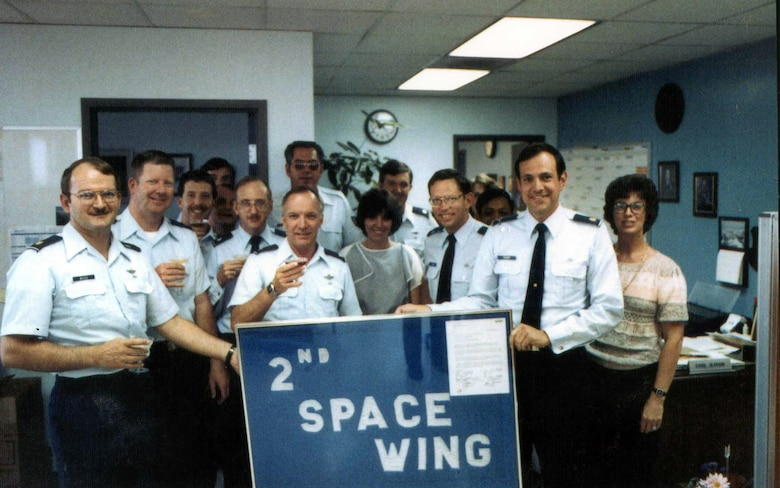 The original 2nd Space Wing staff, July 28, 1985, including Col. Richard Griffin, wing commander at the time (center-front), and Ms. Carol Searson, future 50 SW protocol chief, to his left. (U.S. Air Force courtesy photo)