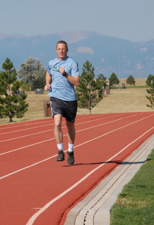 SCHRIEVER AIR FORCE BASE, Colo. -- Staff Sgt. Dave Gapper, 19th Space Operations Squadron, will compete in the Air Force Marathon Saturday at Wright- Patterson Air Force Base along with 13 fellow Schriever members. Sergeant Gapper will compete in the half marathon, but typically prefers longer events. He'll race in more than 20 events this year and completed a 50-mile marathon earlier this month. (U.S. Air Force photo/Scott Prater)