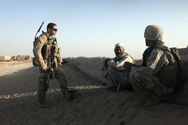 Sgt. Nathan D. McLain, a squad leader with Weapons Platoon, Company B, 1st Light Armored Reconnaissance Battalion, talks with a village elder in Shabu, Afghanistan, Sept. 15. Marines talk to the village elders and citizens of Shabu every day during their patrols.