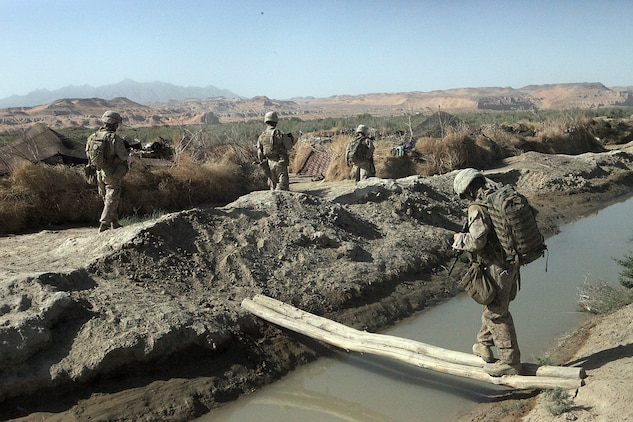 Marines with Weapons Platoon, Company B, 1st Light Armored Reconnaissance Battalion, patrol toward the village of Shabu, Afghanistan Sept. 15. Twice a day the Marines patrol several miles to get to Shabu to maintain village security.