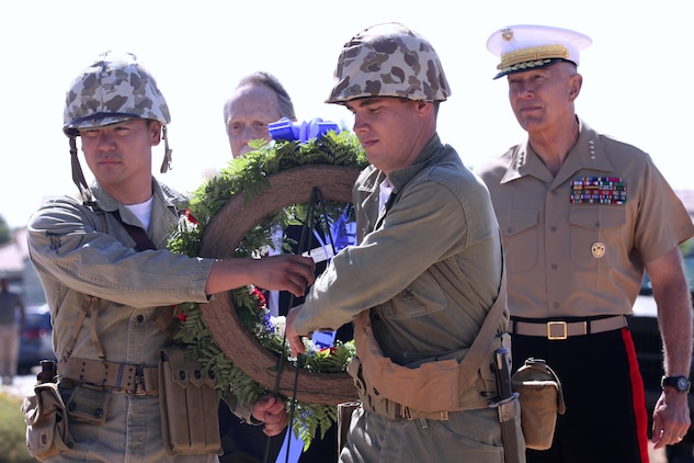 "The 34th Commandant of the Marine Corps, Gen. James T. Conway walks alongside Marines, dressed in Korean War era uniforms, who carry a wreath to be placed in honor of the ""Chosin Few"" during a monument dedication ceremony at the Camp Pendleton South Mesa Club, Sept. 15. The ceremony was held in honor of the 60th anniversary of Operation Chromite; the dangerous and difficult amphibious landing at Inchon, Korea, Sept. 15, 1950."