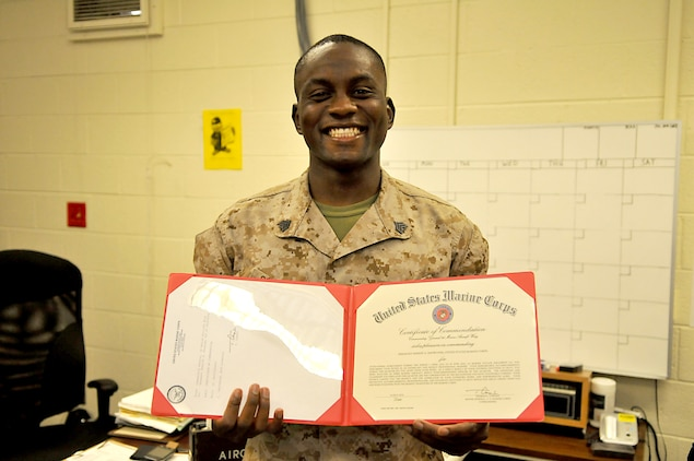 Sgt. Sheriff Showunmi, Marine Attack Squadron 214 maintenance administration clerk, displays his noncommissioned officer of the quarter award from the 3rd Marine Aircraft Wing. Showunmi earned the NCO of the quarter title for the 3rd MAW and the 1st Marine Expeditionary Force.