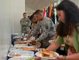 Service members and civilian employees assigned to  U.S. Marine Corps Forces, Pacific, and Pacific Command sample traditional Hispanic dishes during the 5th annual Camp Smith Hispanic Heritage Observance Sept. 17 at the PACOM headquarters building, here. The event featured a guest speaker from the Hispanic community and traditional Hispanic dance demonstrations.