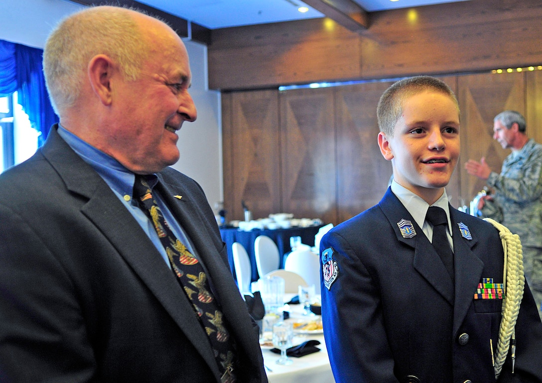 Former prisoner of war, retired Navy Capt. David Hoffman and Christian Britton talk with other servicemembers during the POW/missing in action luncheon Sept. 17, 2010, at Ramstein Air Base, Germany. Christian is Junior ROTC cadet and son of Senior Master Sgt. Vince Britton, 435th Contingency Response Group superintendent of contingency operations. (U.S. Air Force photo/Senior Airman Amanda Dick)