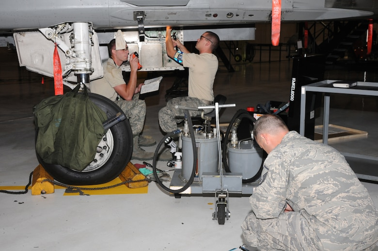 Staff Sergeants Chris Riley and Bryan Rogers, airmen from the 173rd Electro/Environmental shop, perform aircraft maintenance for a member of the Unit Compliance Inspection team at Kingsley Field, Ore., September 18, 2010.  Kingsley Field has been under the microscope by the UCI team this week to ensure the base is performing up to Air Force standards.  (U.S. Air Force photo by Senior Airman Bryan Nealy.) Released