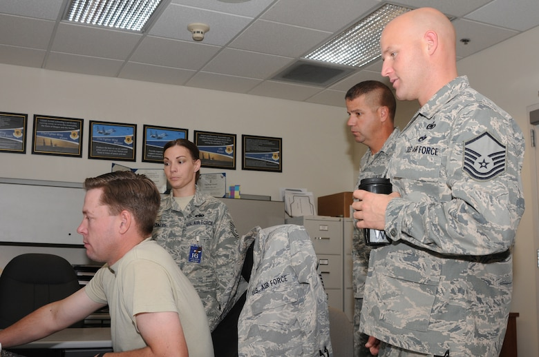 Master Sergeant Mike Loomis, Master Sergeant Jason Witts and Senior Master Sergeant Joe Oyler, 173rd Fighter Wing Traffic Management Flight, are inspected by a member of the Unit Compliance Inspection team at Kingsley Field, Ore., September 18, 2010.  Kingsley Field has been under the microscope by the UCI team this week to ensure the base is performing up to Air Force standards.  (U.S. Air Force photo by Senior Airman Bryan Nealy.) Released