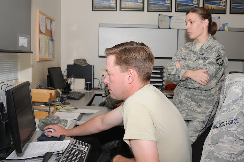 Master Sergeant Mike Loomis, 173rd Fighter Wing Traffic Management Flight, is inspected by a member of the Unit Compliance Inspection team at Kingsley Field, Ore., September 18, 2010.  Kingsley Field has been under the microscope by the UCI team this week to ensure the base is performing up to Air Force standards.  (U.S. Air Force photo by Senior Airman Bryan Nealy.) Released
