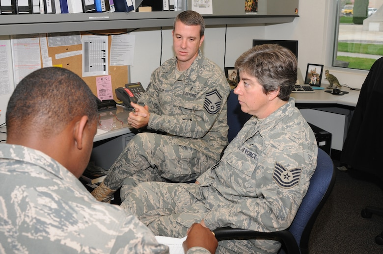 Senior Master Sergeant Jerod Taylor and Tech Sergeant Cody Yeager, airmen in the 173rd Medical Group, review inspection results with a member of the Unit Compliance Inspection team at Kingsley Field, Ore., September 18, 2010.  Kingsley Field has been under the microscope by the UCI team this week to ensure the base is performing up to Air Force standards.  (U.S. Air Force photo by Senior Airman Bryan Nealy.) Released