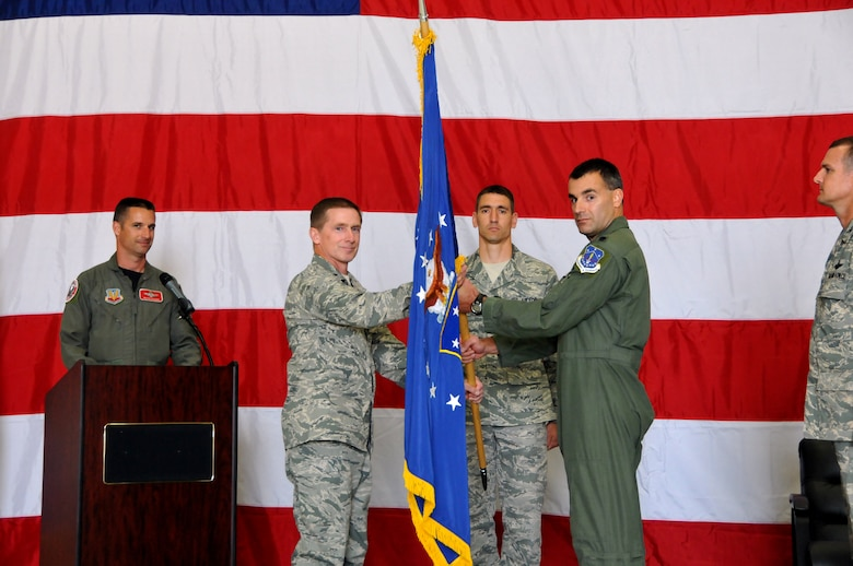 Brig. Gen. Joseph Brandemuehl, 115th Fighter Wing commander, presided over the change of command where Lt. Col. Erik Peterson assumed command of the 115th Operations Group from Col. Jeffrey Wiegand and Colonel Wiegand assumed command of the 115th Maintenance Group from Col. Patrick Volk. (U.S. Air Force photo by Tech. Sgt. Ashley Bell)
