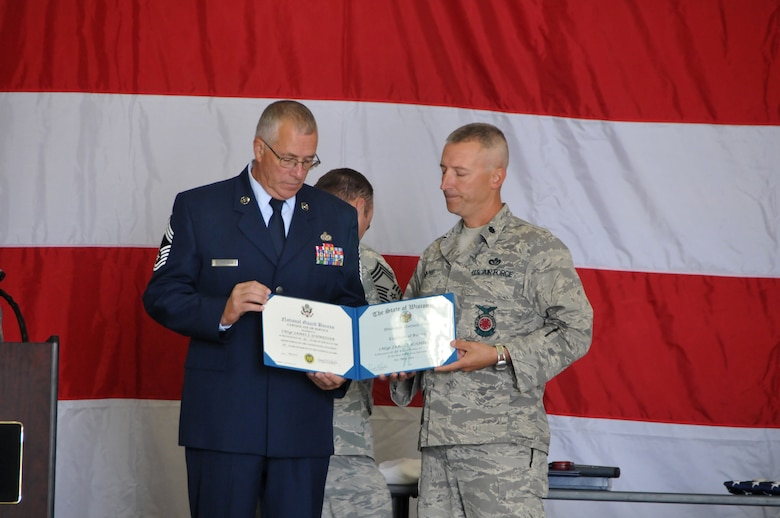The 115th Fighter Wing held a retirement ceremony here for Chief Master Sgt. James Schmeisser, Sept. 18. During nearly 40 years of military service in the Wisconsin Air National Guard, Chief Schmeisser deployed over 15 times with the 115th Civil Engineering Squadron to locations all over the world. In his final year with the 115th FW, Chief Schmeisser served as the interim command chief for nine months. (U.S. Air Force photo by Tech. Sgt. Ashley Bell)