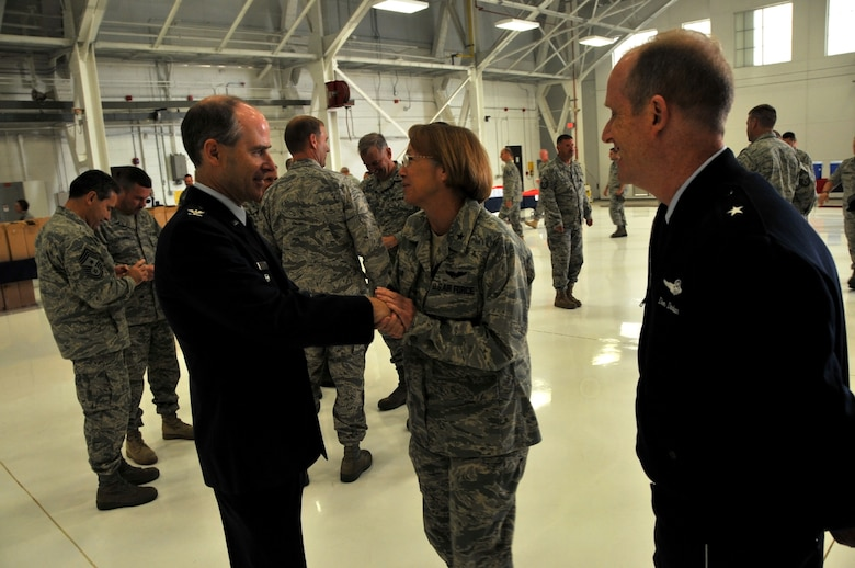 Colonel Michael Hinman accepts congratulations from Brig. Generals Margaret Bair, chief of staff for the Wisconsin Air National Guard, and Donald Dunbar, Wisconsin National Guard adjutant general on a 34 year military career.  As a member of the 115th Fighter Wing, Colonel Hinman served most recently as the vice commander of the wing in Madison. In June, Colonel Hinman was appointed by Governor Jim Doyle as the administrator of Wisconsin Emergency Management. (U.S. Air Force photo by Tech. Sgt. Don Nelson)