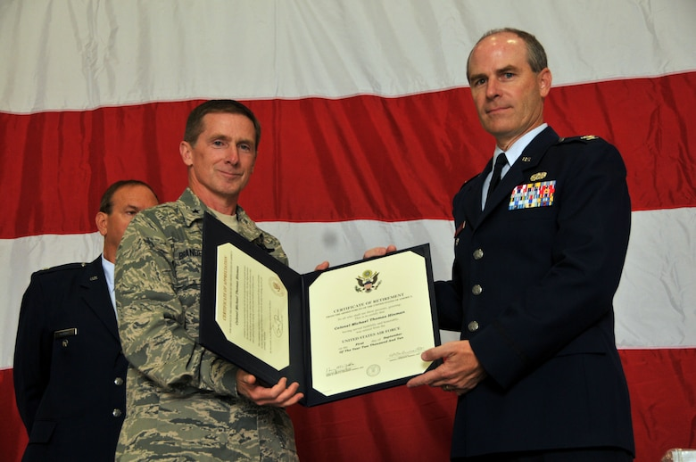 Brigadier General Joseph Brandemuehl, 115th Fighter Wing commander, presents Colonel Michael Hinman his certificate of retirement as he completes a 34 year military career.  As a member of the 115th Fighter Wing, Colonel Hinman served most recently as the vice commander of the wing in Madison. In June, Colonel Hinman was appointed by Governor Jim Doyle as the administrator of Wisconsin Emergency Management. (U.S. Air Force photo by Tech. Sgt. Don Nelson)