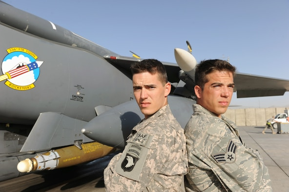 Army Staff Sgt. Jonathan Cole (left) and Senior Airman William Cole stand in front of an F-15E Strike Eagle at Bagram Airfield, Afghanistan. Sergeant Cole is a member of the 101st Airborne Division and Airman Cole is assigned to the 336th Aircraft Maintenance Unit at Bagram Airfield. (U.S. Air Force photo/Tech. Sgt. Drew Nystrom)