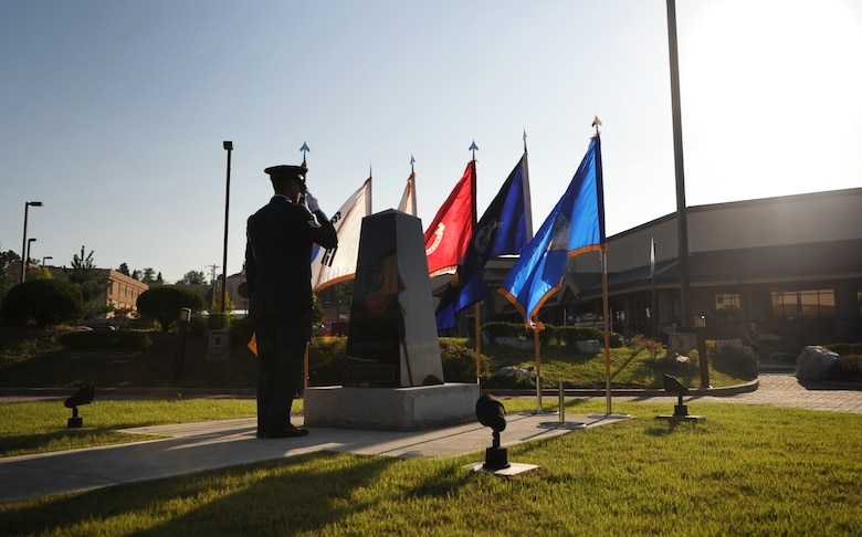 An honor guard member salutes the POW/MIA memorial at Osan Air Base Sept. 16. National POW/MIA Recognition Day is annually observed in the United States on the third Friday of September. The base held observances and ceremonies for the entire week leading up to the national observance. (U.S. Air Force photo/Senior Airman Evelyn Chavez)