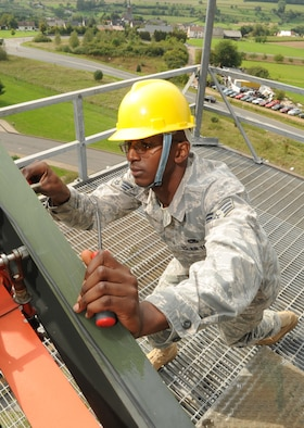 SPANGDAHLEM AIR BASE, Germany - Senior Airman Michael Williams, 52nd Communications Squadron ground radar systems journeyman, checks polarizers on a radar system Sept. 9. Airman Williams is responsible for performing preventative maintenance on the radar systems for proper functioning that provides a vital link between the control tower and aircraft. (U.S. Air Force photo/Airman 1st Class Nick Wilson)