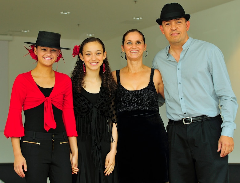 Kelsey Coral and Brianna Judith D'Jesus-Banos, along with Judith Banos-D'Jesus and U.S. Air Force Capt. Ricardo D'Jesus, 86th Medical Group, bioenvironmental engineer, pose for a family portrait after all performing Flamenco, Salsa and Merengue dances during the Hispanic Heritage month kickoff event held at the Kaiserslautern Military Community Center, Ramstein Air Base, Germany, Sept. 18. Both daughters have been performing Jazz, Ballet, Tap and Flamenco for over four years. Capt. and Mrs. D'Jesus, have been performing Salsa and Merengue since the age of twelve. Hispanic Heritage month events celebrate heritage, diversity, integrity and honor and take place from Sept. 15 through Oct. 15 this year. (U.S. Air Force photo by Staff Sgt. Stephen J. Otero)