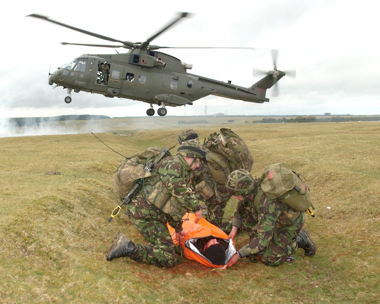 A team of 28 Squadron Royal Air Force Regiment combat medics prepare to transport a 'wounded' soldier to a casualty evacuation helicopter during a training scenario at Davidstow, North Cornwall, England. Realistic combat training is necessary to prepare the medics for combat operations in Southern Afghanistan. (Royal Air Force Photo by RAF Senior Aircraftman Chris Davidson)