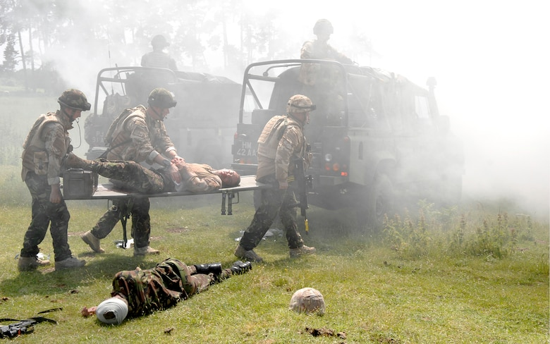 A team of Royal Air Force Regiment infantry medics transport a patient on a litter during an exercise combat scenario at Davidstow, North Cornwall, England. Realistic combat training is necessary to prepare the medics for combat operations in Southern Afghanistan. (Royal Air Force Photo)