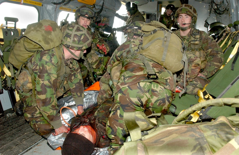 A team of 28 Squadron Royal Air Force Regiment combat medics care for a 'wounded' soldier aboard a casualty evacuation helicopter during a training scenario at Davidstow, North Cornwall, England. The RAF Regiment now uses volunteers who've lost a limb in battle but still want to serve as patients. Utilizing special moulage teams and the fact that the members already have a missing limb, combat medic trainers are able to give their new medics realistic human casualties to treat.  (Royal Air Force Photo by RAF Senior Aircraftman Chris Davidson)