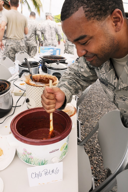 SOTO CANO AIR BASE, Honduras --  Trying to get himself what's left of his chili, Tech. Sgt. Rashaun Monroe, of the 612th Air Base Squadron fire department, realizes there's not much left of the first-place batch after the Air Force Birthday Chili Cook-Off here Sept. 17. The 612th ABS is looking to make the chili cook-off an annual event. (U.S. Air Force photo/Tech. Sgt. Benjamin Rojek)