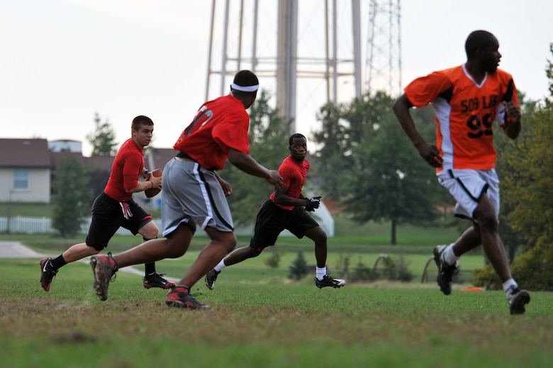 WHITEMAN AIR FORCE BASE, Mo. - Airmen from the 509th Civil Engineer Squadron flag football team face off against the 509th Logistics Readiness Squadron team here Sept. 21. The CES team won with a score of 35-21 over the LRS team. (U.S. Air Force photo/Tech. Sgt. Charles Larkin Sr)