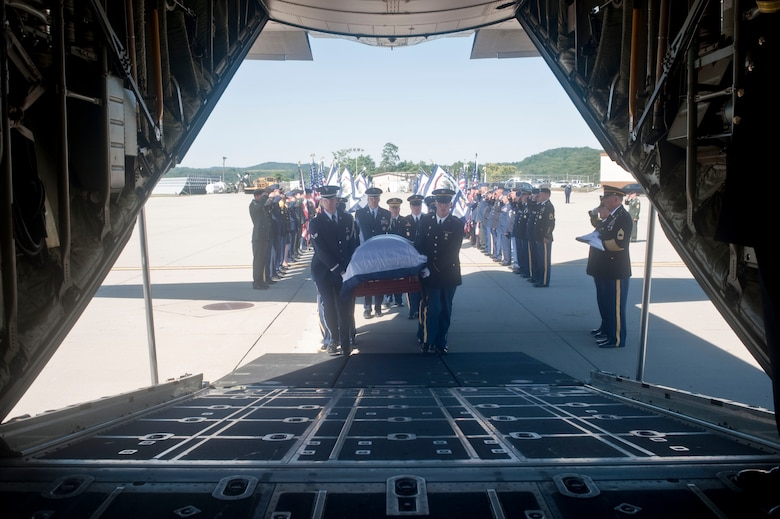 From left, Senior Airman David B. Haynie and Tech. Sgt. Dennis J. Brogan, left center, both members of the 130th AW, carry Sen. Robert C. Byrd's casket onto a C-130 Hercules, July 1, 2010, Charleston, W.Va. (U.S. Air Force photo by Tech. Sgt. Andrew M. LaMoreaux/Released)