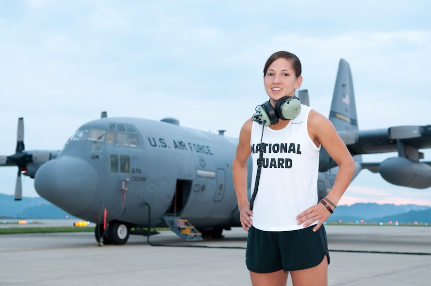 Staff Sgt. Kristen M. Roles, a crew chief with the 130th Airlift Wing, Charleston, W.Va. poses for a portrait with the C-130H3 Hercules aircraft she maintains. Staff Sgt. Roles ran her first race with the All Guard Marathon Team, July 25, 2010, placing 135 out of 2,010 women, in the San Francisco Half-Marathon in San Francisco, Calif. (U.S. Air Force photo by Tech. Sgt. Eugene R. Crist/Released)