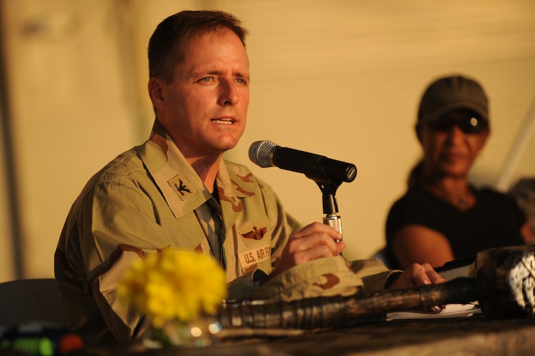 Col. John Wood gives his opening remarks during the combat dining out on Joint Base Charleston, S.C., Sept. 17, 2010. The 437th Airlift Wing hosted the event to promote esprit de corps within the ranks with food, drinks, fun, games and entertainment. Colonel Wood is the 437th Airlift Wing commander. (U.S. Air Force photo/James M. Bowman)(Released)