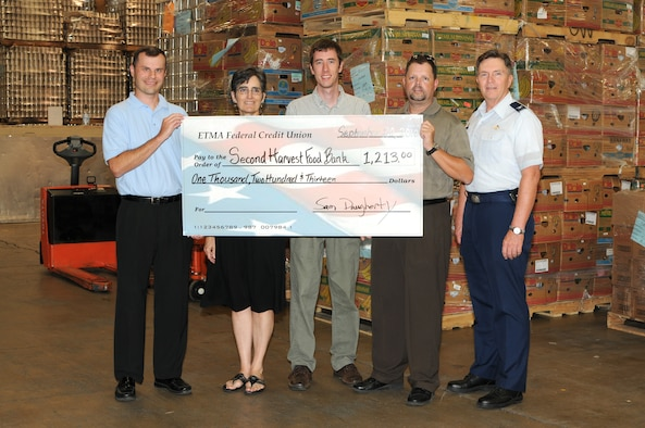 KNOXVILLE, Tenn. - The I.G. Brown Air National Guard Training and Education Center presents a check for $1,213 to the Second Harvest Food Bank of East Tennessee at their distribution center in Knoxville, Sept. 20, 2010. The funds were raised during the 2010 Clod Classic golf tournament.  From L-R are Rick Mikels, East Tennessee Military Association Federal Credit Union; Patty Ford and John Bell, Second Harvest Food Bank; Master Sgt. Sam Daugherty and Col. Richard B. Howard, The I.G. Brown Air National Guard Training and Education Center.  (U.S. Air Force photo by Master Sgt. Mavi Smith/Released)