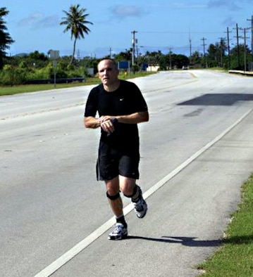 Captain David Leonard, an Andersen chaplain, runs the 26 miles between the base chapel here and the chapel at Naval Base Guam Sept. 11. The date has dual importance for the Captain, not only is it a day of remembrance and reflection for those who lost their lives, but also his 41st birthday. (U.S. Air Force Courtesy Photo)