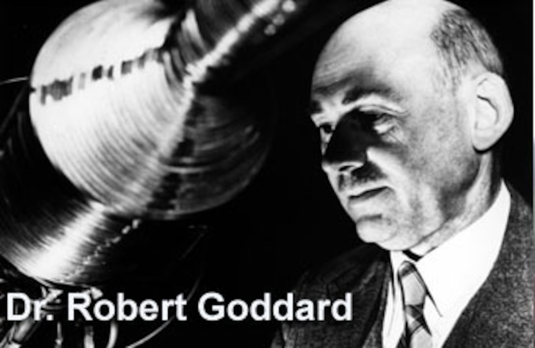 """Dr. Robert Goddard, the """"father"""" of American rocketry, photographed with one his inventions, circa 1932. (Photo courtesy NASA)"""