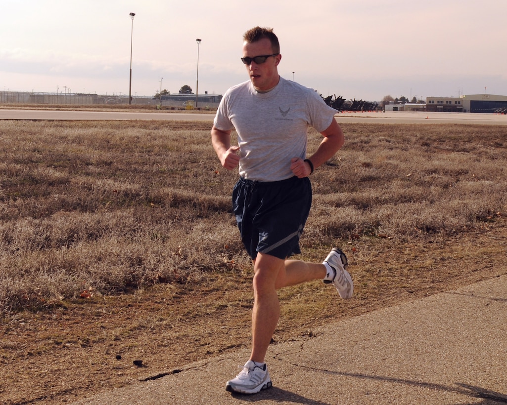 Staff Sgt. Josh Williams, a military pay technician for the 124th Fighter Wing finance section, completes the 1.5 mile run portion of his fitness test. (Air Force photo by Staff Sgt. Heather Walsh)(Released)