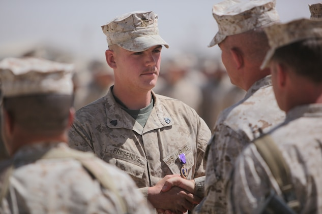 "Sergeant David Fresenius, an assistant team leader with 3rd Platoon, Bravo Company, 1st Reconnaissance Battalion, is awarded the Purple Heart by Brig. Gen. Joseph Osterman, 1st Marine Division (Forward) commanding general, aboard Camp Leatherneck, Sept. 23. The 23-year-old from Westminster, Calif., was hit in the top of his back's protective Sapi plate during a small arms fire engagement in Trek Nawa, on June 21, 2010.  The round lodged in his protective gear, just millimeters away from breaking skin and hitting his upper spine.  After his corpsman attended to the wound, that left a baseball-sized welt in his upper back, a very lucky and determined Fresenius re-donned his gear, and got back in the engagement with the Taliban that lasted just over an hour. ""It felt like I had been hit with a sledge hammer,"" Fresenius said.  ""Once I realized I was okay, my only thoughts were to get back to the fight – to get back with my men."""