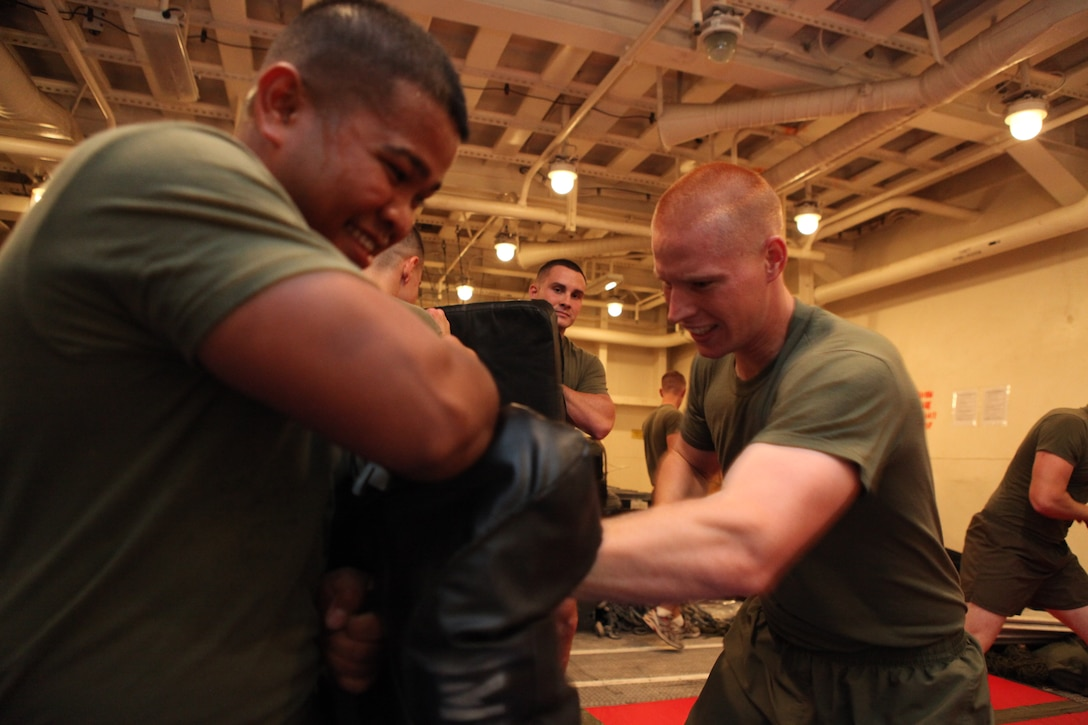 """Lance Cpl. Nicholas J. Klein, an armorer with Company L, Battalion Landing Team 3/8, 26th Marine Expeditionary Unit, practices throwing punches during physical training in the """"dojo"""" aboard USS Carter Hall in the U.S. Navy Fifth Fleet Area of Responsibility, Sept. 24, 2010. 26th Marine Expeditionary Unit is currently embarked aboard the ships of Kearsarge Amphibious Ready Group operating in the U.S. Navy 5th Fleet Area of Responsibility."""