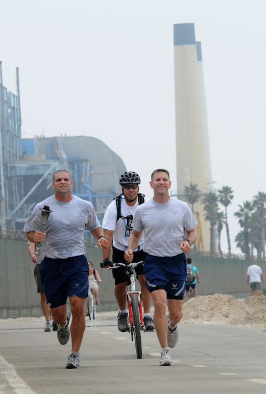 Runners pass by the power plant and beach in El Segundo on the way to Los Angeles AFB during the 24-hour POW-MIA relay, Sept. 16.  Runners traveled 21 miles from Fort MacArthur in San Pedro to Los Angeles Air Force Base in El Segundo. The relay lasted 24-hours with personnel running through the night around the base's track. (Photo by Joe Juarez)