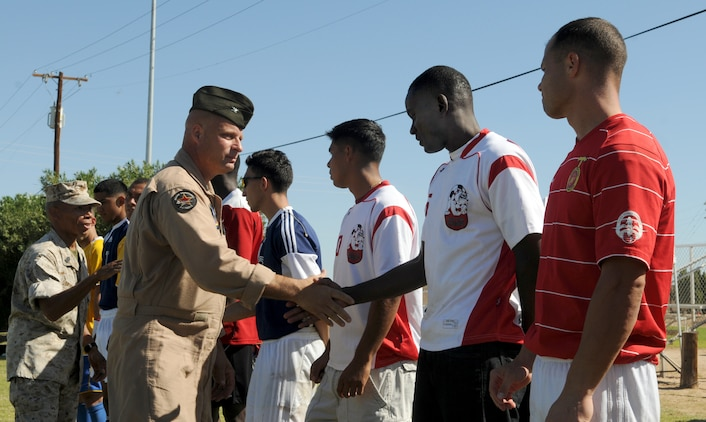 Col. Mark A. Werth, station commanding officer, and Sgt. Maj. Terry D. Stanford, shake hands with players from the West Coast Regional Soccer Tournament at the Marine Corps Air Station in Yuma, Ariz., Sept. 24, 2010. Two Yuma-based Marines were selected for All-Marine Soccer Team tryouts.